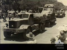 Tanks and transporters of the Australian Armoured Regiment moving through the city streets during the unit parade. The leading tank transporter is from the Australian Tank Transport Company, Australian Army Service Corps. Transport Companies, Army Vehicles, Ww2 Tanks, Military Gear, Transporter, City Streets, Perth, Wwii, Antique Cars