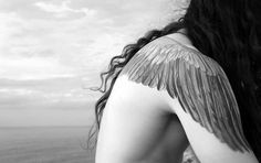 Perfect flow of this wing tattoo between the shoulder and arm, tattooed women, feather tattoo