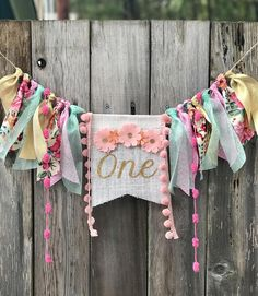 Flower crown first birthday banner! Soft blush hues and glitter accents make up this unique boho floral highchair banner. Can be made for any age & used as a high chair banner or wall decoration. Each banner is custom made just for you! Pennant measures approx 6x9 with 6 inches of