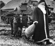 Santa Claus with the children during Croatian War. Vukovar, 1992