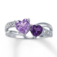 This enchanting fine jewelry ring features twin heart-shaped amethysts nestled between waves of sterling silver and a row of brilliant diamonds.  Gently clean by rinsing in warm water and drying with a soft cloth.