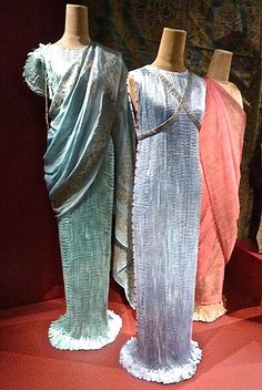 Because Fortuny was not a fashion designer per se, he could afford to disregard trends and his designs remained true to his vision for decades. By 1925, the Delphos was considered a tea gown and by the 30′s was adopted as an evening dress, known for its columnar shape, elaborate pleating and Venetian glass beads, which served as both decoration and to anchor the featherweight silk,