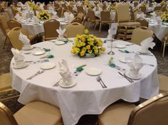 72 centerpieces of yellow roses and yellow daisies.