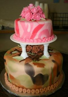 His and Her's Camo Wedding cake Makes me think of u crystal...but u would Soooo not have pink lol