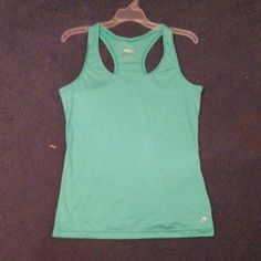Turquoise workout tank top No champion, just advertised for more views. The brand is Spaulding. Work out tank top. Worn a few times. Too big for me. True to size. I negotiate within reason, please use offer button. Champion Tops Tank Tops