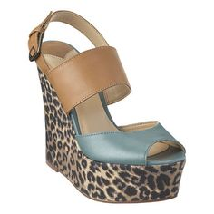 """Platform sandal with wrapped wedge detailing. Adjustable buckle closure. Leather upper. Measurements: wedge 5 1/4"""" and platform 1 3/4"""". This style is available exclusively @ Nine West Stores  ninewest.com."""