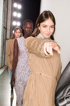 A happy model points during her return from the Jason Wu catwalk at New York Fashion Week.