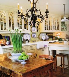 This is almost my kitchen! I need/want/love the black chandelier!!!