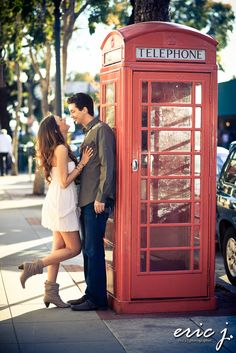 Engagement photo idea. the colors are terrific, the couple is adorable, and the focus is perfect. now i just have to find an old-fashioned telephone booth...