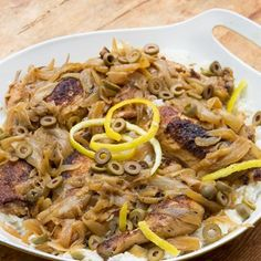 SENEGALESE CHICKEN YASSA: Tender chicken braised with lots of lemon and caramelized onions. Delicious with fluffy white rice!