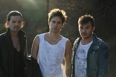 Tomo Miličević, Jared Leto & Shannon Leto - 30 Seconds To Mars: Mix of denims and cut up tees.