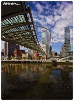 Zubizuri bridge, Bilbao with the Isozaki towers at the end