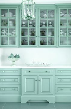 aqua kitchen cabinets. lovely work space. More