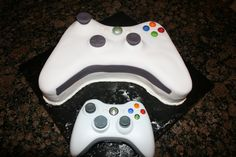 Xbox cake with real controller below it