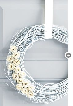 Pretty! Spray paint a grapevine wreath, add felt rosettes. (styleathome.com)