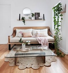 Shelf above the couch / sofa with art and plants. h_and_g_designs