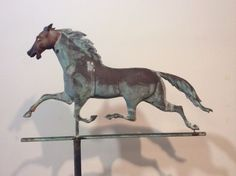 "Complete original weathervane of running horse with directionals. Horse has cast iron head and copper body. Condition is good with expected wear and old bullet hole repairs. The horse measures 17"" high x 28"" wide. Mounted on directionals, the height is 48"". Shipping will be extra. 