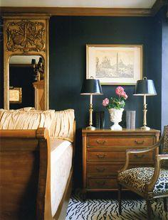 Sophisticated bedroom with dark walls