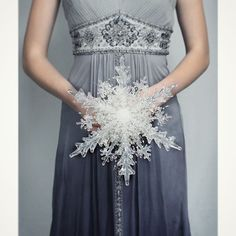 The Snowflake Bridal Bouquet.  Tis the season to start planing for a winter wedding!  #snowflakes #snowflakebouquet #brides #bridalcouture #winterwedding #snowflake #bridalbouquet #crystal #ice #fabulous #whimsical #bridalstyle #broochbouquet #kykampfeld #bridalbouquetsbyky