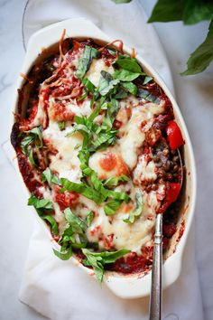 An easy vegetarian casserole recipe with lentils, vegetables, and mozzarella cheese is topped with fresh basil. This delicious lentil bake makes a healthy vegetarian or vegan dinner. Vegan Lentil Soup, Lentil Dishes, Lentil Recipes, Pork Recipes, Vegan Recipes, Vegan Food, Diet Recipes, Lentil Casserole, Vegan Casserole