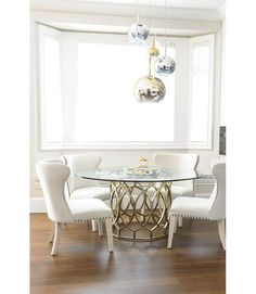 Glass And Metalic Round Dining Table With Shiny Pendant Lighting