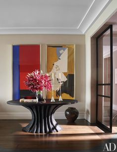 A pair of Robert Motherwell works hang in a corner of the living room; the bespoke Christian Astuguevieille table is graced with vintage Gene Summers sterling-silver candlesticks.