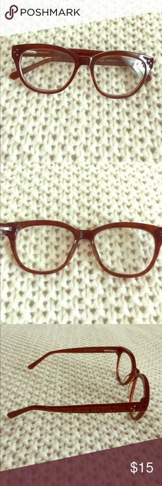 Brown eyeglasses frames Larger than standard frames, but wouldn't say they're oversized.  No name brand.  Dark brown plastic with three silver dots on both the corners of the frames and sides of the arms.  Still have my (mild) prescription lenses in them. Accessories Glasses