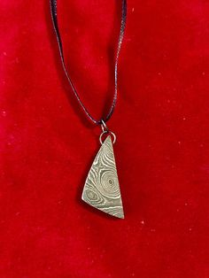Damascus Steel pendant in a stunning raindrop pattern. Pendant comes on a ribbon necklace. Each item is handcrafted with care. FREE DOMESTIC SHIPPING