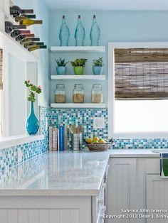 {gorgeous backsplash + white cabinets + bottles / SBO}