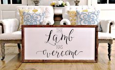 """""""The Lamb Has Overcome"""" Approximately 17"""" x 25"""" Printed Board + Stained Wood Frame Please note these boards are lightweight (2-5 pounds) making decorating and rearranging a breeze! Hangers are include"""