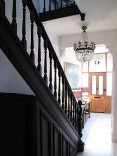Black stair railing, black staircase, black and white stairs, staircase ide Black Stair Railing, Black Staircase, Staircase Ideas, Painted Staircases, Painted Stairs, Black And White Stairs, Entryway Chandelier, Hallway Designs, Ideas