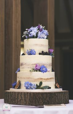 Semi-naked wedding cake with hints of the 2018 colour - ultra violet.