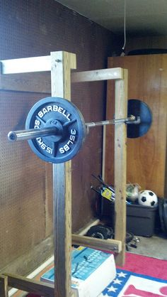 Depending on the amount of weight the Squat Rack can become a standing overhead press rack as seen here.
