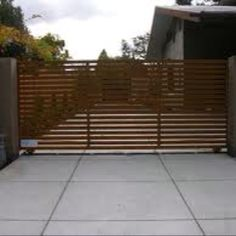 Driveway gate. Horizontal lines could become a recurring theme throughout the house wherever security screens or shade is needed. Bathroom courtyard.