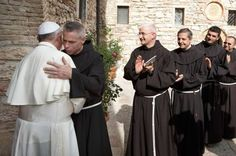Franciscan Father Michael Perry, minister-general of the Order of Friars Minor, embraces Pope Francis during his visit to the hermitage and cell of St. Francis in Assisi, Italy