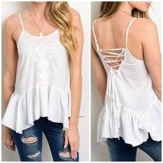 """SALE $23White boho tank top Flouncy and flirty tank top. Spaghetti straps. Floral embroidery design on the center front and dropped waistline. Cross cross back for a sexy look. 50% polyester 50% cotton. Adjustable straps. SMALL: 34"""" bust & length is 26"""". LARGE: 36"""" & length is 28"""". ☀️15% off bundles for new buyers☀️25% off bundles for repeat buyers ☀️ CupofTea Tops Tank Tops"""