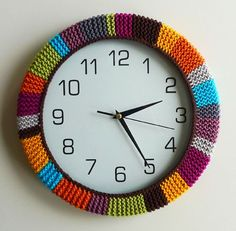 wall clock yarnbomb.  would be cute on the ugly clock in my mom's bathroom at Longview.