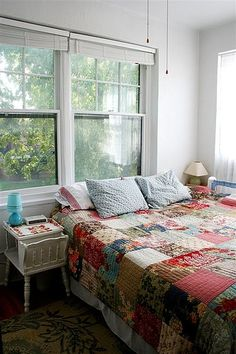 This quilt reminds me of my Nanny's homemade quilts that she covered us with when we were little!