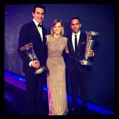 The Wolff's along with the 2014 World Champion Lewis Hamilton. Or, the Constructors cup meets the World Championship trophy.