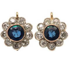 Edwardian. Platinum, 18k Gold, Sapphire and Diamond Floral Cluster Earrings, c1910.