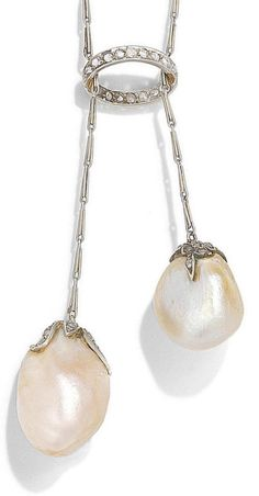 An Edwardian pearl and diamond negligée necklace, circa 1905. The 19.4mm x 9.7mm baroque cultured pearl of pink tint and the 14.5mm x 11.9mm baroque natural pearl of cream tint, each with a rose-cut diamond foliate cap, suspended from a similarly-cut diamond halo on fetter-link chains, to a fetter-link backchain, lengths: pendant 6cm, chain 37.2cm. #Edwardian #necklace #negligee