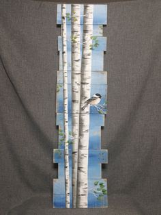 White Birch Pallet art, Pine tree Reclaimed Wood Pallet Art, TALL Hand painted Aspen, Chickadee bird, upcycled, blue Wall art, Distressed Original Acrylic painting on reclaimed Pallet boards. This unique piece is 46 tall x 9-12 wide Perfect for that skinny wall space. All of my creations are made of reclaimed boards. They are hand painted and are made after they are ordered. Although I try to duplicate original as closely as possible, there may be slight variations because no two boards…