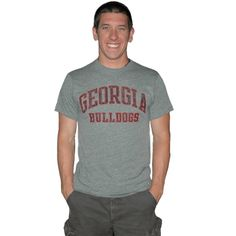 UGA Men's GA Bulldogs on Gray Tee. University of Georgia Men's classic fit heathered (gray) t-shirt with arched Georgia over Bulldogs.