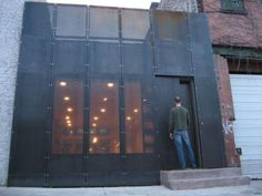 facade in black glass - juxtaposition of old brick buildings on either side..so cool