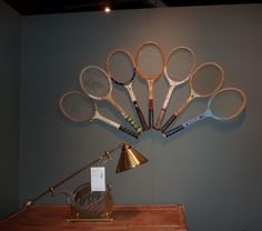 Old tennis racquets repurposed for wall art