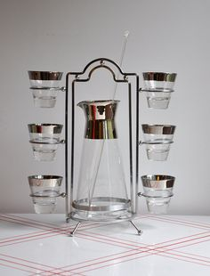 1 glass - minus everything else. :o/  Dorothy Thorpe Pitcher & 8 Glass Set.