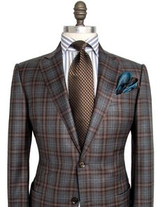 Ermenegildo Zegna Taupe with Chocolate and Blue Plaid Sportcoat 2 button jacket Notch lapel Taupe melton Front left chest pocket Bucket pockets Fully lined Chocolate lining Double vent Drop: 7 Model: mila 100% wool Made in Italy