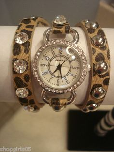 NEW! GENEVA WRAP WATCH, THIS IS THE NEWEST MOST WANTED WATCH!! HAS STAINLESS STEEL BACK, JAPAN MOVEMENT AND WTER RESISTANT. NICE!! COLOR IS TAN AND BROWN LEOPARD PRINT , SILVER  AND RHINESTONES-STUDS.