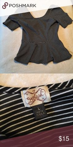 Black&White Stripe Peplum Black and white striped peplum. Lightly Worn. Size L. Made in USA. If you have any questions please feel free to ask :) Tops Tees - Short Sleeve