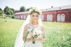 Real wedding in Finland. Dress made by Pukuni (www.pukuni.fi). Wedding dress with lace back and tulle. Photography / Minttu Saarni